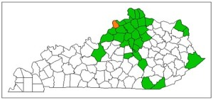 Figure 1. Counties previously under limited state quarantines for emerald ash borer are shaded green . This insect was found last week in Trimble County (orange).