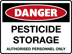 Figure 1.  Post signs on doors and windows of the pesticide storage area.