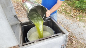 Figure 2. Concentration of juice to make sorghum syrup requires additional pesticide residue testing to label pesticides for this crop. Residues in the juice potenially can increase as the water is removed to make syrup. (Photo: Ric Bessin, UK)